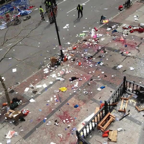 This photo provided by Bruce Mendelsohn shows the scene after two explosions occurred during the 2013 Boston Marathon in Boston, Monday, April 15, 2013. (AP Photo/ Bruce Mendelsohn) MANDATORY CREDIT
