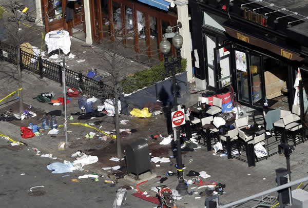 "<div class=""meta ""><span class=""caption-text "">One of the blast sites on Boylston Street near the finish line of the 2013 Boston Marathon is seen in Boston, Tuesday, April 16, 2013, one day after bomb blasts killed three and injured over 140 people. FBI agents searched a suburban Boston apartment overnight and appealed to the public for amateur video and photos that might yield clues to who carried out the Boston Marathon bombing. (AP Photo/Elise Amendola)</span></div>"