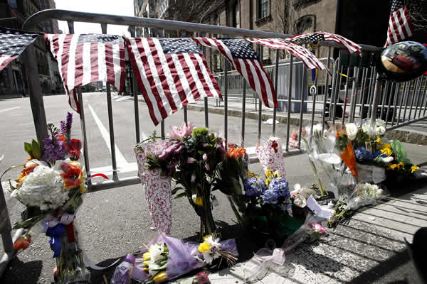 "<div class=""meta ""><span class=""caption-text "">Flowers sit at a police barrier near the finish line of the Boston Marathon in Boston Tuesday, April 16, 2013. The bombs that ripped through the crowd at the Boston Marathon, killing at least three people and wounding more than 170, were fashioned out of pressure cookers and packed with shards of metal, nails and ball bearings to inflict maximum carnage, a person briefed on the investigation said Tuesday. (AP Photo/Winslow Townson)</span></div>"