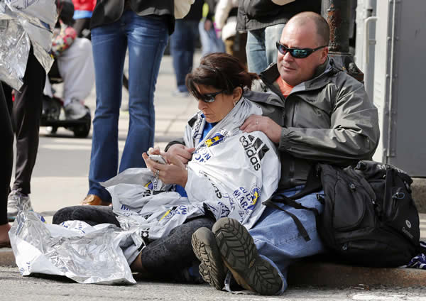 "<div class=""meta ""><span class=""caption-text "">Chris Darmody, right, holds his wife Sue in Boston, Monday, April 15, 2013. Chris says he was waiting for Sue when an explosion detonated near his location at the finish line of the Boston Marathon. The couple were later reunited after all runners were diverted from the course. (AP Photo/Michael Dwyer)</span></div>"
