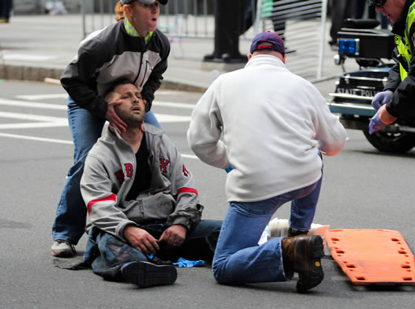 "<div class=""meta image-caption""><div class=""origin-logo origin-image ""><span></span></div><span class=""caption-text"">In this photo provided by The Daily Free Press and Kenshin Okubo, people assist an injured after an explosion at the 2013 Boston Marathon in Boston, Monday, April 15, 2013. Two explosions shattered the euphoria of the Boston Marathon finish line on Monday, sending authorities out on the course to carry off the injured while the stragglers were rerouted away from the smoking site of the blasts. (AP Photo/The Daily Free Press, Kenshin Okubo) MANDATORY CREDIT</span></div>"