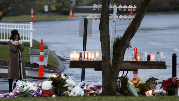 "<div class=""meta ""><span class=""caption-text "">A woman reacts while paying respects for shooting victims at a makeshift memorial at St. Rose of Lima Roman Catholic Church, Sunday, Dec. 16, 2012, in Newtown, Conn. On Friday, a gunman allegedly killed his mother at their home and then opened fire inside the Sandy Hook Elementary School in Newtown, killing 26 people, including 20 children. (AP Photo/Julio Cortez)</span></div>"