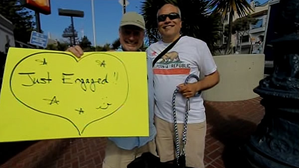 A couple holds a &#34;just engaged&#34; sign in San Francisco&#39;s Castro neighborhood after the Supreme Court&#39;s ruling on Proposition 8. <span class=meta>(KGO)</span>