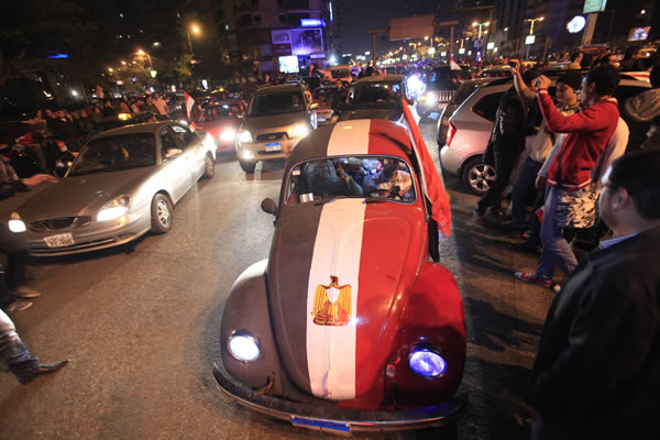 An old Volkswagen car is painted in Egyptian flag colors during celebrations after President Hosni Mubarak resigned and handed power to the military in Cairo, Egypt, Friday, Feb. 11, 2011. Egypt exploded with joy, tears, and relief after pro-democracy protesters brought down President Hosni Mubarak with a momentous march on his palaces and state TV. Mubarak, who until the end seemed unable to grasp the depth of resentment over his three decades of authoritarian rule, finally resigned Friday and handed power to the military.(AP Photo/Amr Nabil)
