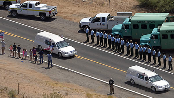 "<div class=""meta ""><span class=""caption-text "">(Two of a procession of 19 hearses drive through the desert, near Congress, Ariz, Sunday, July 7, 2013, to bring the bodies of 19 colleagues who died in a wildfire a week ago. (AP Photo/Mark J. Terrill))</span></div>"