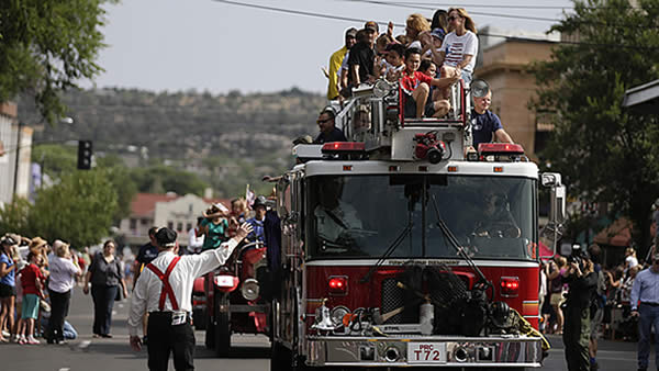 "<div class=""meta ""><span class=""caption-text "">(A fire truck carrying friends and family members of the Granite Mountain Interagency Hotshot Crew leads the Prescott Frontier Days Rodeo Parade Saturday, July 6, 2013 in Prescott, Ariz. (AP Photo/Chris Carlson))</span></div>"