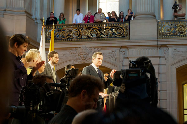 Lieutenant Gavin Newsom addressing a crowd at City Hall about the Supreme Court's decisions on prop. 8 and DOMA