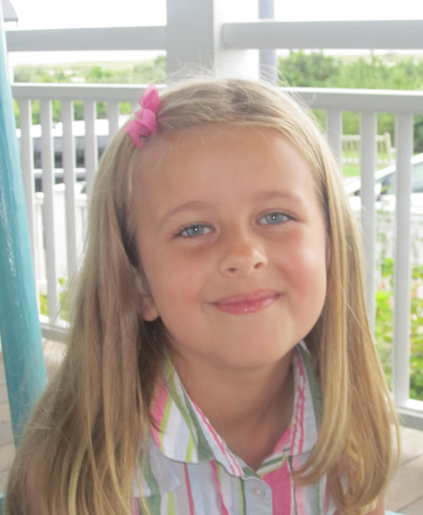 This image provided by the family shows Grace McDonnell posing for a portrait in this family photo taken Aug. 18, 2012. Grace McDonnell was killed Friday, Dec. 14, 2012, when a gunman opened fire at Sandy Hook elementary school in Newtown, Conn., killing 26 children and adults at the school. (AP Photo/Courtesy of the McDonnell Family)