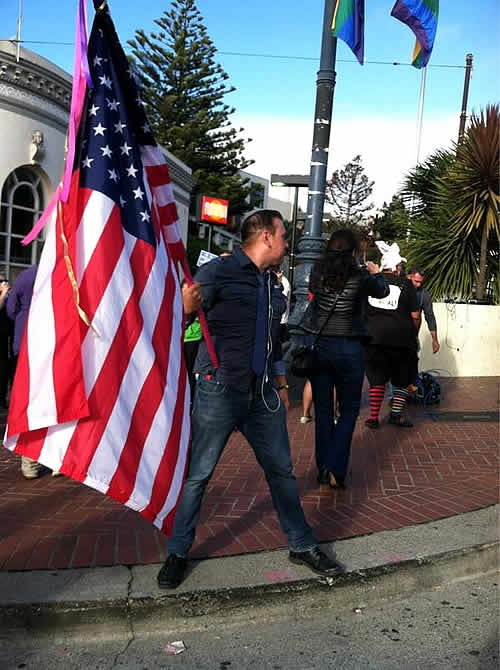 Same-sex marriage supporter holds an American flag in San Francisco's Castro neighborhood after the Supreme Court's ruling on Proposition 8.