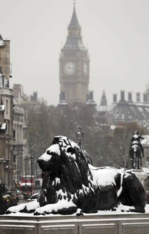Snow covers the Lions' statues in central London's Trafalgar Square, following a night of heavy snow,Thursday, Dec. 2, 2010. More heavy snow caused havoc across Britain on Thursday, keeping Gatwick airport closed for a second day, disrupting rail services and leaving travellers stranded. Commuters struggled to get to work as Britain's worst early winter weather in almost two decades showed no sign of easing its icy grip. (AP Photo/Lefteris Pitarakis)