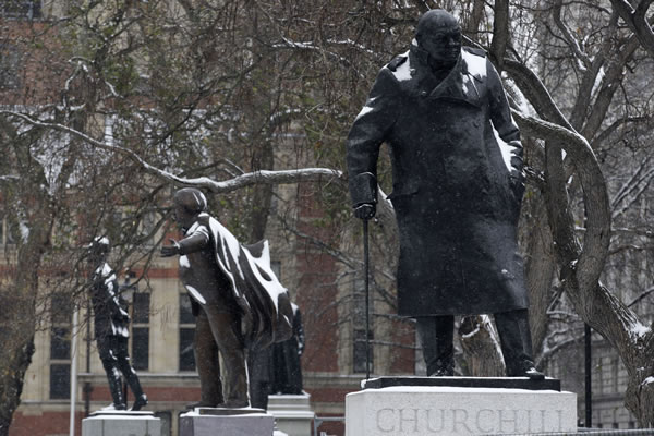 Snow covered statues, including that of Sir Winston Churchill, foreground, Britains's World War II prime minister, are seen at Parliament Square in London, Thursday, Dec. 2, 2010. Britain is continue gripped by severe weather condition. (AP Photo/Sang Tan)
