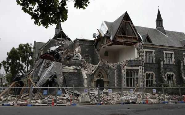 A building in Christchurch, New Zealand, is destroyed after an earthquake struck Tues