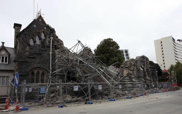 A building in Christchurch, New Zealand, is destroyed after an earthquake struck Tuesday, Feb. 22, 2011. The 6.3-magnitude quake collapsed buildings and is sending rescuers scrambling to help trapped people amid reports of multiple deaths. (AP Photo/NZPA, Pam Johnson)
