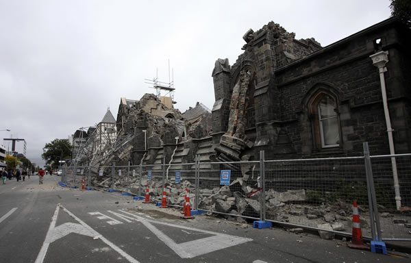 "<div class=""meta ""><span class=""caption-text "">A building in Christchurch, New Zealand, is destroyed after an earthquake struck Tuesday, Feb. 22, 2011. The 6.3-magnitude quake collapsed buildings and is sending rescuers scrambling to help trapped people amid reports of multiple deaths. (AP Photo/NZPA, Pam Johnson)</span></div>"