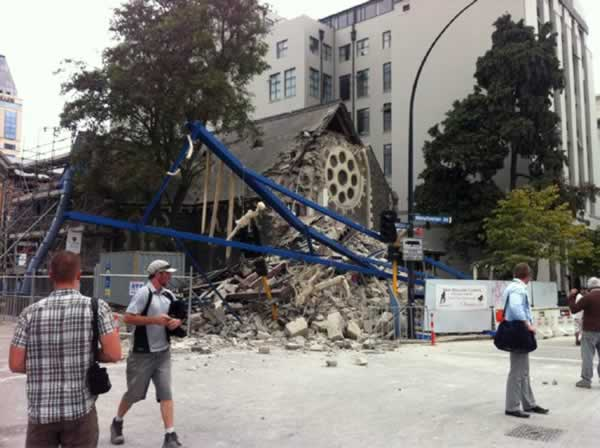 "<div class=""meta image-caption""><div class=""origin-logo origin-image ""><span></span></div><span class=""caption-text"">People look at a damaged church after a powerful earthquake struck Christchurch, New Zealand, Tuesday, Feb, 22, 2011. The 6.3-magnitude quake collapsed buildings and is sending rescuers scrambling to help trapped people amid reports of multiple deaths. (AP Photo/Layton Duncan)</span></div>"