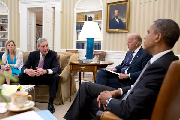 President Barack Obama and Vice President Joe Biden meet with senior advisors in the Oval Office to discuss the shootings in Aurora, Colorado, July 20, 2012. Pictured, from left, are: Kathryn Ruemmler, Counsel to the President, and FBI Director Robert Mueller. (Official White House Photo by Pete Souza)