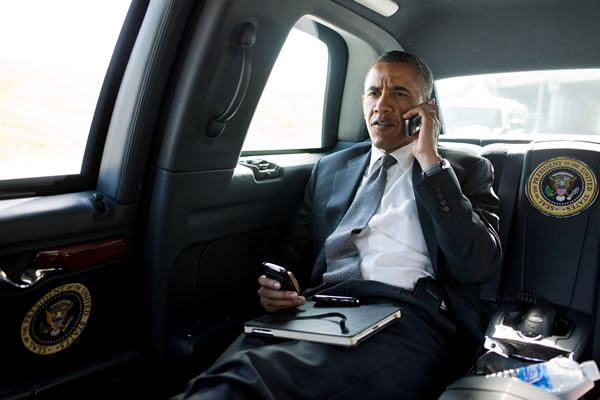 President Barack Obama talks on the phone with Aurora Mayor Steve Hogan during the motorcade ride to Palm Beach International Airport in Palm Beach, Fla., July 20, 2012. The President called Mayor Hogan to offer his condolences and support to the Aurora community. (Official White House Photo by Pete Souza)