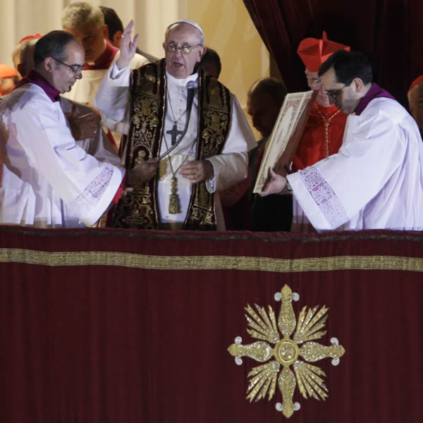 Pope Francis blesses the crowd from the central balcony of St. Peter's Basilica at the Vatican, Wednesday, March 13, 2013