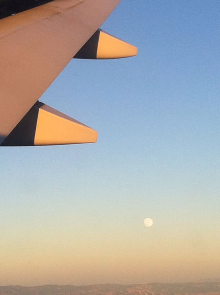 Supermoon spotted as plane lands at SFO. (Photo submitted via uReport by Sue. Photo taken by her daughter Emma)