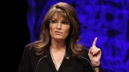 Former vice presidential candidate Sarah Palin addresses attendees at the National Tea Party Convention in Nashville.