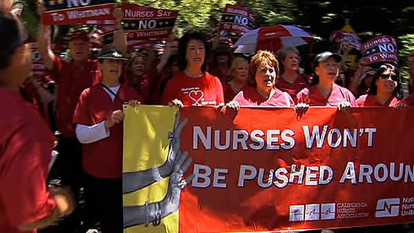1,100 nurses demonstrate outside Whitman's house