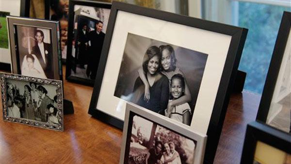 Family photos are displayed in the Oval Office behind President Obama's desk, Tuesday, Aug. 31, 2010, at the White House in Washington.
