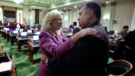 Assemblywoman Cathleen Galgiani, D-Livingston, left, hugs Assembly Speaker John Perez, D-Los Angeles, after an all night session ended at the Capitol in Sacramento, Calif., Friday, Oct. 8, 2010.