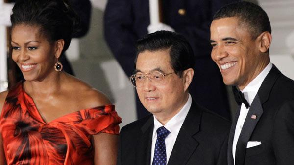 President Barack Obama and first lady Michelle Obama welcome China's President Hu Jintao to the North Portico of the White House in Washington, Wednesday, Jan. 19, 2011, for the State Dinner. (AP Photo/Charles Dharapak)
