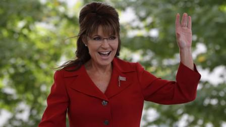 Former vice presidential candidate and Alaska Gov. Sarah Palin waves to supporters before addressing a Tea Partly Express Rally in Manchester, N.H.