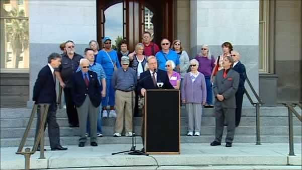 Seniors march on capitol claiming elder fraud