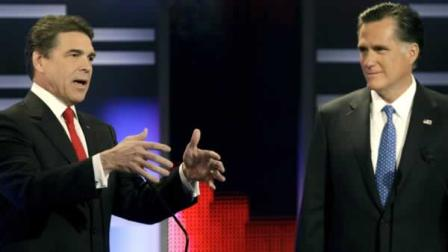 Republican presidential candidates Texas Gov. Rick Perry, left, and former Massachusetts Gov. Mitt Romney take part in the Republican debate, Saturday, Dec. 10, 2011, in Des Moines, Iowa. (AP Photo/Charlie Neibergall)