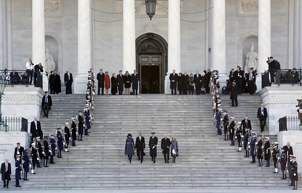 "<div class=""meta ""><span class=""caption-text "">Army Major General Michael Linnington, Joint Forces Headquarters, National Capitol Region, center, leads President Barack Obama and first lady Michele Obama, and Vice President Joe Biden and his wife Jill Biden, to their positions to review the troops following the 57th Presidential Inauguration at the U.S. Capitol in Washington, Monday, Jan. 21, 2013. (AP Photo/Cliff Owen)</span></div>"