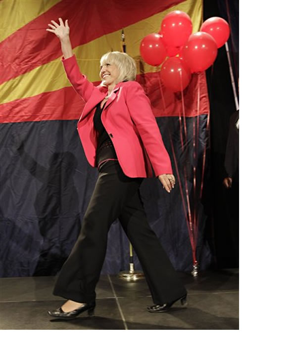 "<div class=""meta image-caption""><div class=""origin-logo origin-image ""><span></span></div><span class=""caption-text"">Arizona Gov. Jan Brewer takes the stage Tuesday, Nov. 2, 2010, at an election night party in Phoenix. (AP Photo/Matt York)</span></div>"