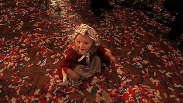 Liberty Zweck, plays in confetti after Wisconsin Republican gubernatorial candidate Scott Walker's victory party, Tuesday, Nov, 2, 2010, in Pewaukee, Wis. (AP Photo/Jeffrey Phelps)