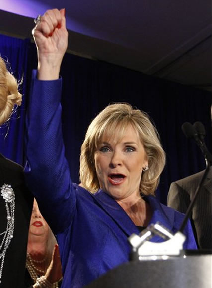 Oklahoma Governor-elect Mary Fallin gestures to the crowd during a victory party in Oklahoma City, Tuesday, Nov. 2, 2010. Fallin becomes the first woman governor of the state of Oklahoma. (AP Photo/Sue Ogrocki)