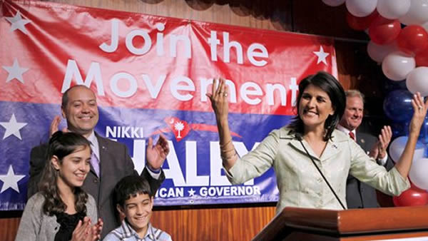 South Carolina Gov.-elect Nikki Haley, right, gives her acceptance speech as husband, Michael, rear left, daughter Rena, 12, front left, and son Nalin, 9, look on in the early hours Wednesday, Nov. 3, 2010, in Columbia, SC. (AP Photo/David Goldman)