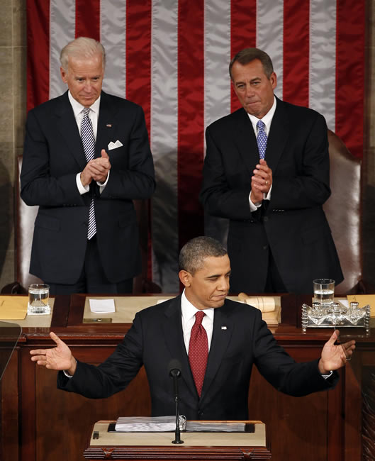 Vice President Joe Biden and House Speaker John Boehner of Ohio applaud President Barack Obama on Capitol Hill in Washington, Tuesday, Jan. 24, 2012, as the president gives his State of the Union address. <span class=meta>(AP Photo - J. Scott Applewhite)</span>