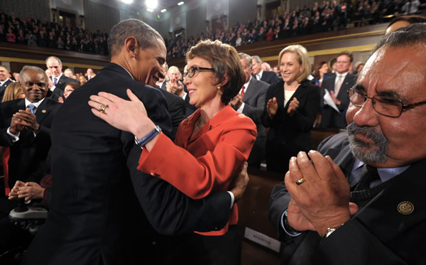 President Barack Obama embraces retiring Rep. Gabrielle Giffords, D-Ariz., as members of Congress applaud before his State of the Union address in front of a joint session of Congress Tuesday, Jan. 24, 2012, on Capitol Hill in Washington. <span class=meta>(AP Photo - Saul Loeb)</span>
