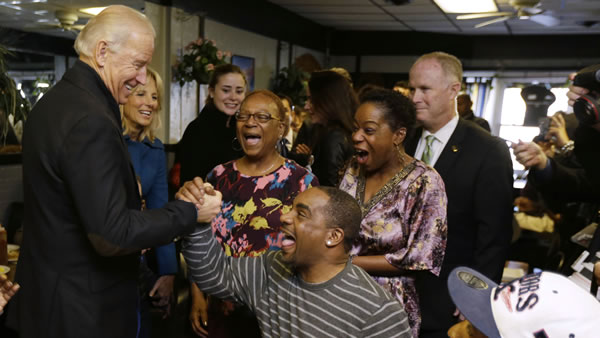 "<div class=""meta ""><span class=""caption-text "">Vice President Joe Biden, accompanied by his wife Jill Biden, meets with patrons during a visit to the Landmark Restaurant, Tuesday, Nov. 6, 2012, in Cleveland, Ohio. (AP Photo/Matt Rourke)</span></div>"