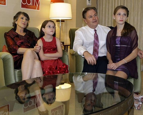 "<div class=""meta image-caption""><div class=""origin-logo origin-image ""><span></span></div><span class=""caption-text"">California Republican Senate candidate Carly Fiorina, her granddaughter Kara Tribby, 7, her husband Frank, and granddaughter Morgan Tribby, 11, from left, applaud national election returns on television in their hotel room at California GOP election night headquarters in Irvine, Calif., Tuesday, Nov. 2, 2010. Sen. Barbara Boxer, D-Calif., defeated Fiorina. (AP Photo/Reed Saxon)</span></div>"