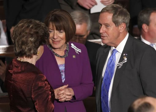 Rep. Joe Wilson, R-S.C., right, talks with Del. Madeleine Bordallo, D-Guam, left, and Rep, Susan Davis, D-Calif., on Capitol Hill in Washington, Tuesday, Jan. 25, 2011, prior to the start of President Barack Obama's State of the Union address. (AP Photo/Evan Vucci)