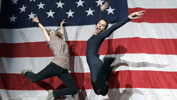 Supporters of President Barack Obama Shauna Harry, left, and Alana Hearn celebrate by leaping in the air at New York State Democratic Headquarters following Election Day, Tuesday, Nov. 6, 2012. (AP Photo/Kathy Willens)