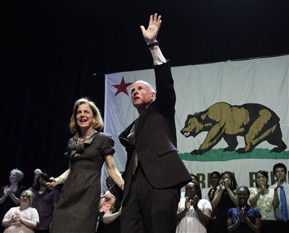California Gov.-elect Jerry Brown celebrates his election win during a rally with his wife, Anne Gust, in Oakland, Calif., Tuesday, Nov. 2, 2010. Brown defeated Meg Whitman, former CEO of eBay. (AP Photo/Eric Risberg)