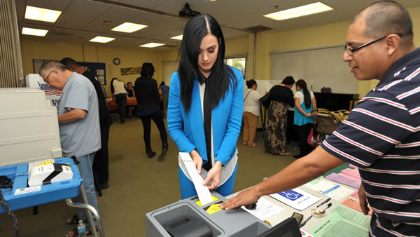 Singer Katy Perry submits her election ballot at a polling place in Los Angeles on Tuesday Nov. 6, 2012. (Photo by John Shearer/Invision/AP)