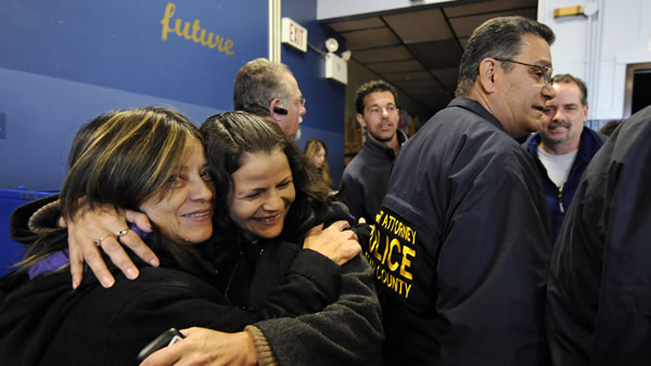 "<div class=""meta ""><span class=""caption-text "">Two women embrace after voting at East Elementary School on Tuesday, Nov. 6, 2012, in Long Beach, N.Y., one of several voting locations that were created as a result of Superstorm Sandy. Election Day turnout was heavy Tuesday in several storm-ravaged areas in New York and New Jersey, with many voters expressing relief and even elation at being able to vote at all, considering the devastation. (AP Photo/Kathy Kmonicek)</span></div>"