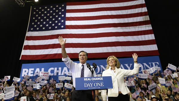 Republican presidential candidate, former Massachusetts Gov. Mitt Romney and his wife Ann Romney take the stage at a Virginia campaign rally, Monday, Nov. 5, 2012, at The Patriot Center, George Mason University in Fairfax, Va. (AP Photo/Charles Dharapak)