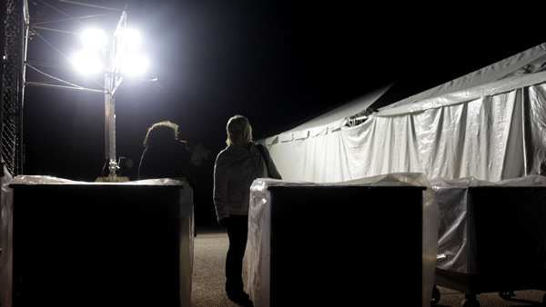 "<div class=""meta ""><span class=""caption-text "">Under the lights of a generator, poll workers and voting machines voters wait outside of a tent serving as a polling site in the Midland Beach section of Staten Island, New York, on Election Day, Tuesday, Nov. 6, 2012. The original polling site, a school, was damaged by Superstorm Sandy. (AP Photo/Seth Wenig)</span></div>"