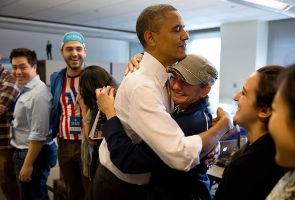 President Obama hugs a emotional campaign staffer.  The president made a surprise visit to his campaign headquarters in Chicago this afternoon to thank the staff and volunteers who helped him win re-election.