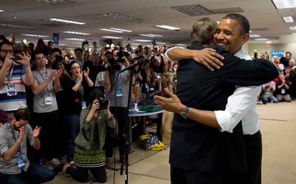 President Obama hugging his campaign manager, Jim Messina.  The president made a surprise visit to his campaign headquarters in Chicago this afternoon to thank the staff and volunteers who helped him win re-election.