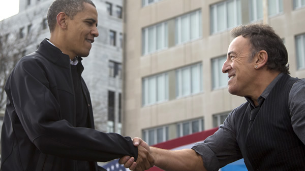 President Barack Obama shakes hands with singer Bruce Springsteen after speaking at a campaign event, Monday, Nov. 5, 2012, in downtown Madison, Wis. (AP Photo/Carolyn Kaster)